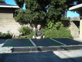 Greg Smestad with Solyndra PV panels